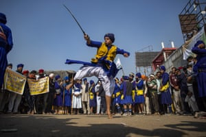 A nihang or a Sikh warrior displays his Sikh martial art skills at the Delhi-Haryana state border
