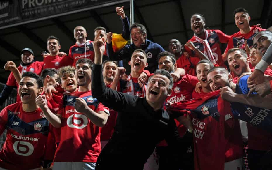 Christophe Galtier leads the celebrations as Lille wins the championship.