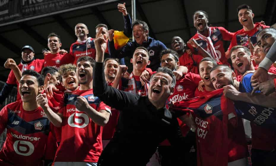 Christophe Galtier and his Lille players celebrate after winning the title.