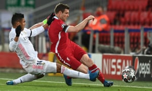 Real Madrid's Casemiro clatters into James Milner.