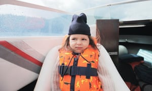 Girl with seasickness on boat (posed by model)