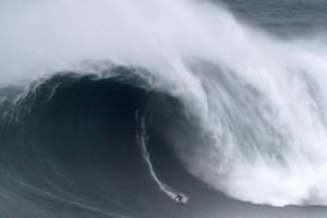 Kai Lenny from Hawaii rides a wave during the Nazaré Tow Surfing Challenge at Praia do Norte.