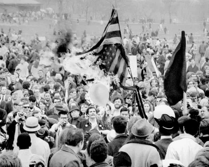 Anti-Vietnam war demonstrators burn the flag in Central Park, 1967.