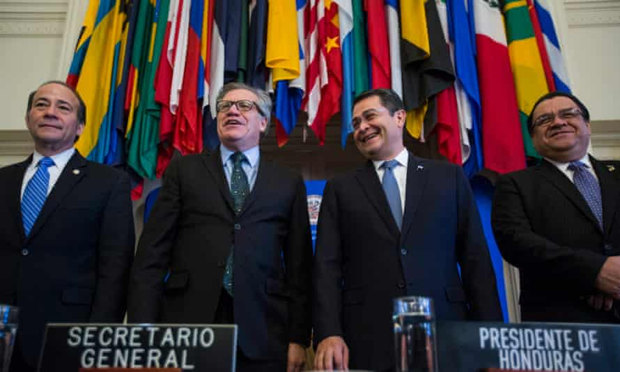 The President of Honduras, Juan Orlando Hernández (second right) stands alongside, Luis Almagro, secretary general of the OAS, during a ceremony establishing the anti-corruption body Maccih in Washington on Tuesday.
