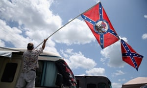 A fan holds a Confederate flag during practice for the Nascar Xfinity Series at Daytona Beach in Florida.