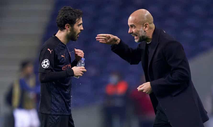 The Manchester City head coach Pep Guardiola (right) gives instructions to Bernardo Silva on Tuesday.