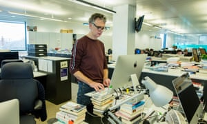 'The ergonomics need fine-tuning …' Sam Wollaston at his desk.