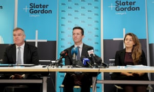 Slater and Gordon Lawyers Rory Walsh, Andrew Baker and Ebony Birchall at a media conference at the firm's Melbourne offices on Wednesday 14 June .
