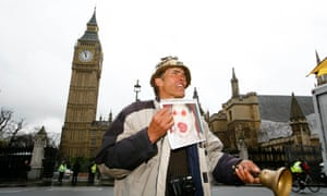 Anti-war protester Brian Haw demonstrates outside the Houses of Parliament in London.