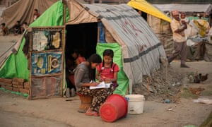 In Kathmandu, girls do their homework outside their tent at Chuchepati displacement camp, a shelter for earthquake victims