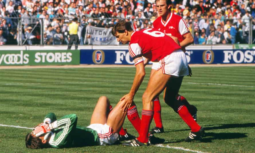 Tony Adams and Martin Hayes console goalkeeper John Lukic after Arsenal lose to Luton in the League Cup final.