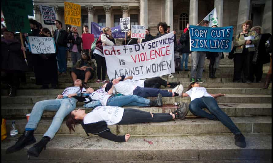 Direct action stunt by Sisters Uncut, a UK-wide feminist group whose members take direct action locally to defend domestic violence services, outside Portsmouth's Guildhall.