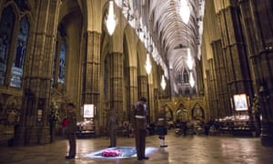 British military personnel stand at the Grave of the Unknown Warrior during a vigil to commemorate the centenary of the Battle of the Somme at Westminster Abbey  in London