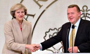 Britain's Prime Minister Theresa May (L) shakes hands with Danish counterpart Lars Lokke Rasmussen at Marienborg estate, near Copenhagen, Denmark.