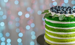 Nice sponge happy birthday cake with mascarpone and grapes on the cake stand on festive light bokehEFC4JG Nice sponge happy birthday cake with mascarpone and grapes on the cake stand on festive light bokeh