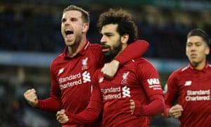 Jordan Henderson celebrates Mohamed Salah's successful penalty.