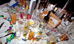 table littered with empty bottles and glasses