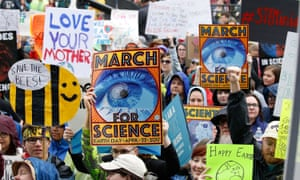Earth Day March For Science Rally - Washington, DC<br>WASHINGTON, DC - APRIL 22:  Demonstrators hold signs during the Earth Day March for Science Rally on the National Mall on April 22, 2017 in Washington, DC.  (Photo by Paul Morigi/Getty Images)