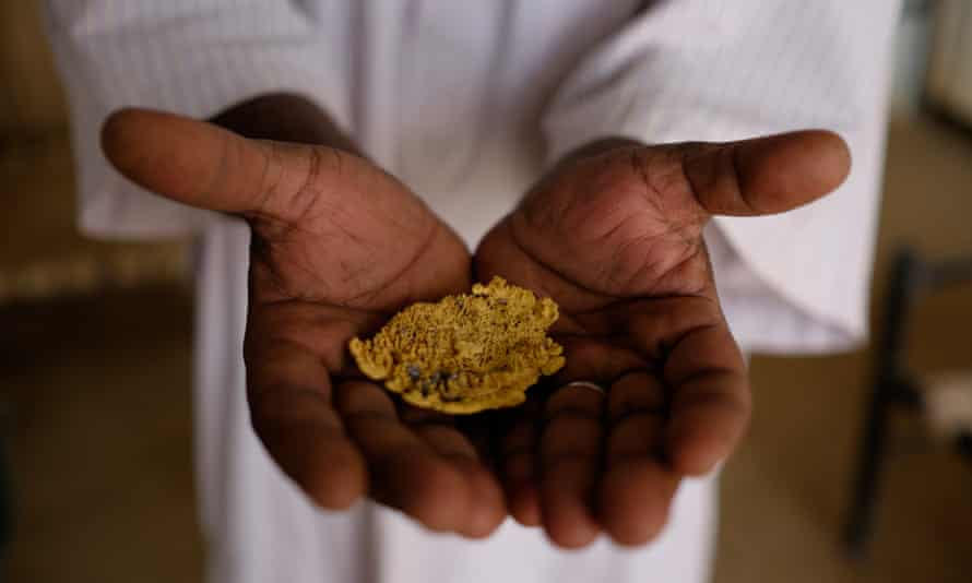 Salahuddein Salah, site manager of the El-Etimad mine, displays gold derived through the mercury and cyanide process.