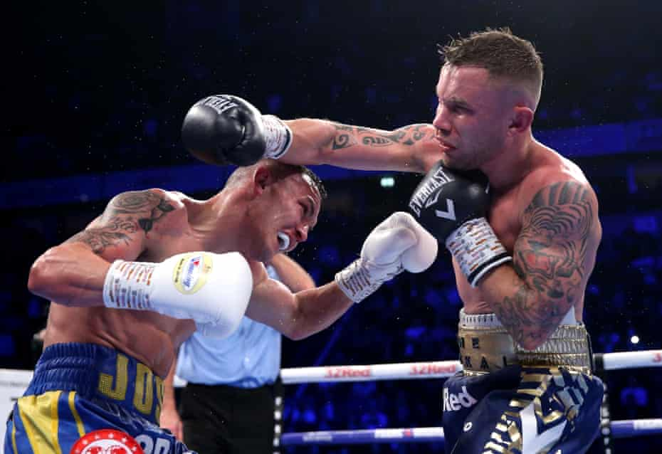 Josh Warrington and Carl Frampton exchange punches during their title fight in December 2018.