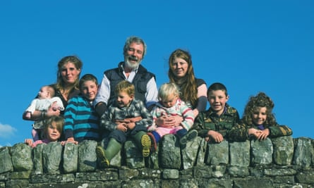Amanda and Clive Owen with eight of their children at their Yorkshire Dales farm, Ravenseat.