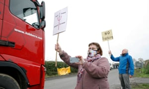 Anti-fracking protesters stand outside KM8 as lorries leave the site in Kirby Misperton, North Yorkshire.