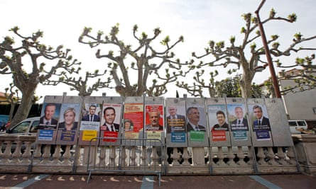 Campaign posters of the 11 candidates who run in the 2017 French presidential election.