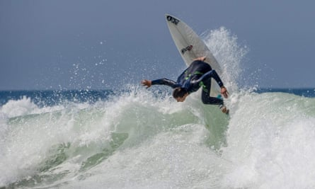 A surfer wearing a Picture Organic wetsuit