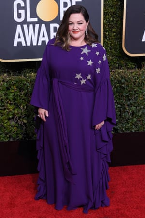 Melissa McCarthy ina Reem Acra star-embellished purple gown.