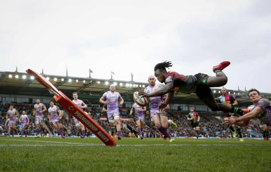 Gabriel Ibitoye of Harlequins dives over to score a try against Exeter at Sandy Park on 2 February.