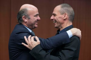 Spanish economy Minister Luis de Guindos (left) greets Greek Finance Minister Yanis Varoufakis at a euro zone Finance Ministers meeting (Eurogroup) in Brussels March 9, 2015. Euro zone officials played down plans submitted by cash-strapped Greece to its international creditors in a bid to secure fresh funds, a day after Athens' outspoken finance minister irked EU partners by raising the prospect of a referendum. REUTERS/Yves Herman (BELGIUM - Tags: POLITICS BUSINESS TPX IMAGES OF THE DAY)