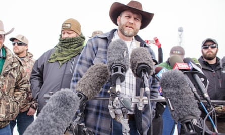 Ammon Bundy speaks to the media as other members look on at the Malheur National Wildlife Refuge near Burns, Oregon.