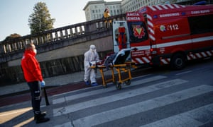 An ambulance carrying a Covid patient is seen outside Santa Maria Hospital in Lisbon, Portugal.
