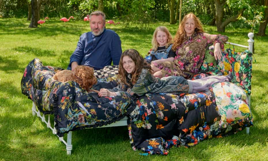 Fashion designers Justin Thornton and Thea Bregazzi, and their daughters, in their one-acre garden at home in Walberswick, Suffolk