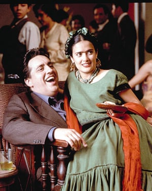 Mexican heroine: Hayek playing Frida Kahlo in Frida with Alfred Molina as Diego Rivera.