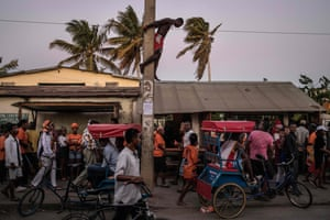 A man climbs an electricity pole in Tuléar, Madagascar