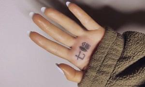 Ariana Grande's 'charcoal grill' tattoo.