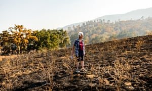 Claire Camp, 91, surveys the burned areas of her ranch in Napa. Camp's daughter Leonore, who lives on the same property, lost her house to the LNU Lightning Complex fire.