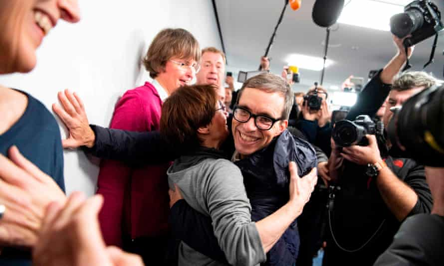 Jens Söring celebrating with supporters at a press conference after his arrival in Frankfurt.