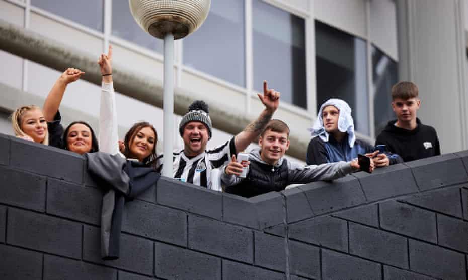 Newcastle fans celebrate outside St James' Park