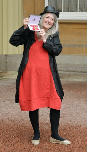 Mary Beard with her OBE medal in 2013.
