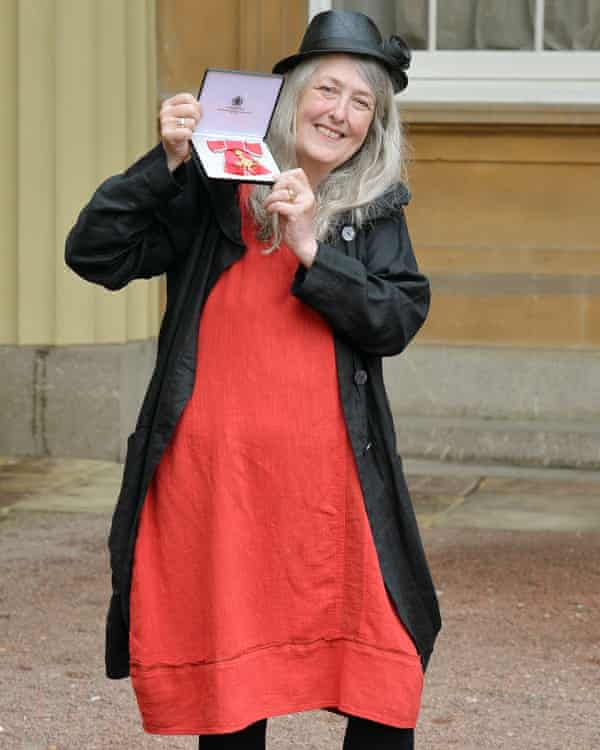 Beard receiving an OBE medal at Buckingham Palace in 2013.