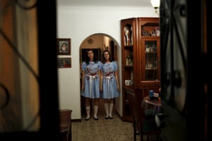 Sisters dressed as the Grady twins from the movie 'The Shining', pose for a photo inside their house during Halloween celebrations near Malaga in Spain.