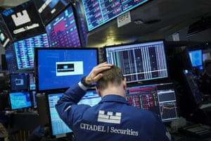 A trader works at his desk during the closing bell on the floor of the New York Stock Exchange last night