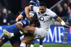 England's centre Ben Te'o is tackled by France's centre Mathieu Bastareaud.