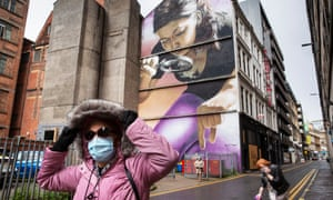A woman in a mask in Glasgow