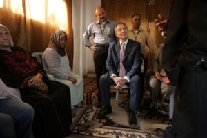 Blair meets a Palestinian family in the Kalandia refugee camp in 2007.
