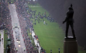 Best died aged 59 from multiple organ failure at the Cromwell hospital in London. Thousands gathered along the streets of Belfast as his funeral cortege came through on 3 December 2005<br>