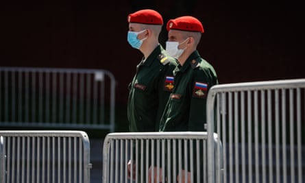 Russian military personnel wearing masks near Red Square in Moscow