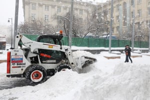 A snowplough out in the streets.